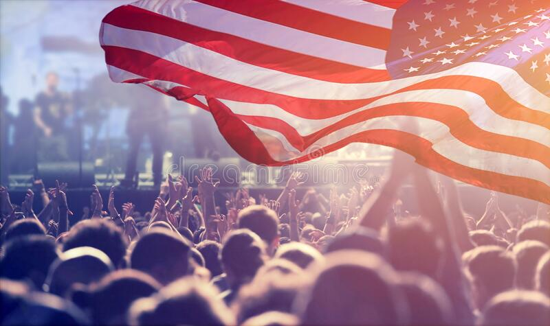 United States flag - crowd celebrating 4th of July Independence Day royalty free stock images