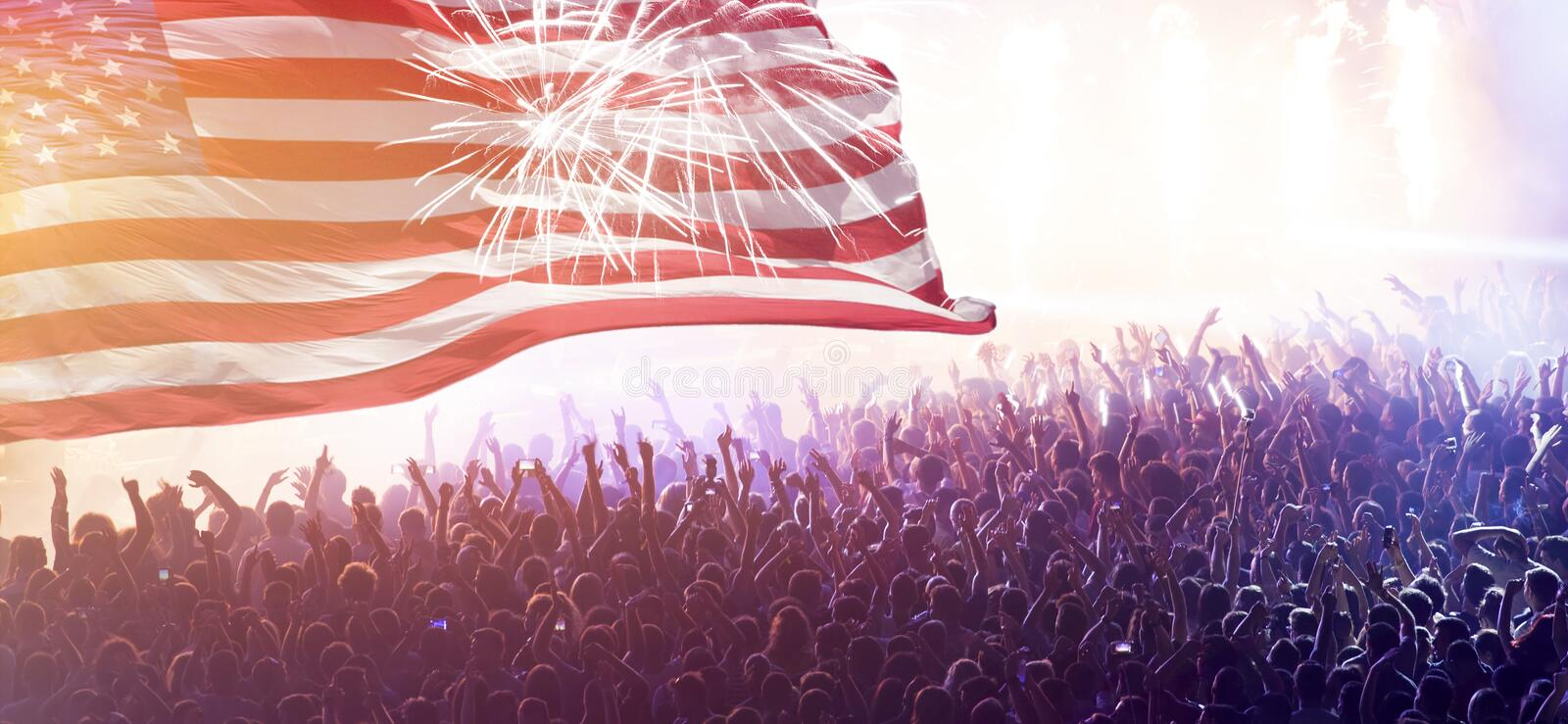 United States flag - crowd celebrating 4th of July Independence Day stock photo