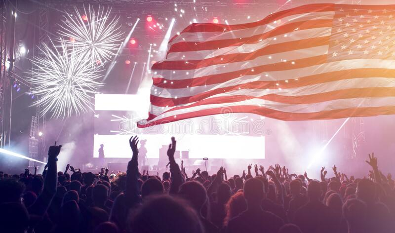 United States flag - crowd celebrating 4th of July Independence Day stock photography