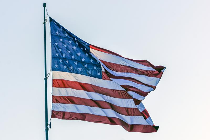 United States Flag. The United States Flag flies high above Foss Harbor Marina in Tacoma, Washington stock photography