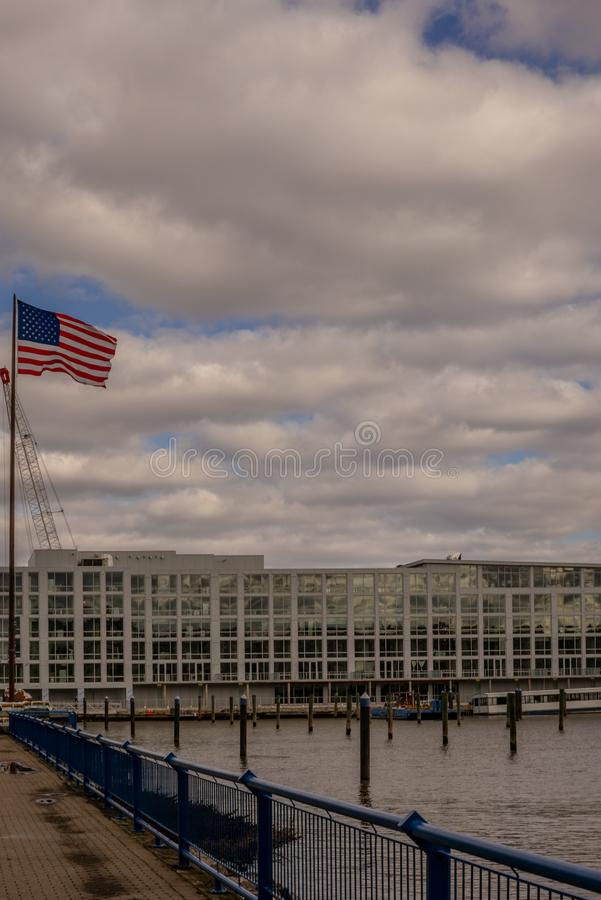 The United States flag flying on the Hudson river in New Jersey. 1 stock images