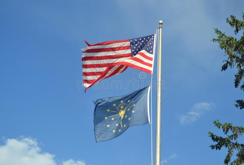 United States Flag and Marion County, Indiana Flag. Summertime. Blue sky with clouds stock photos