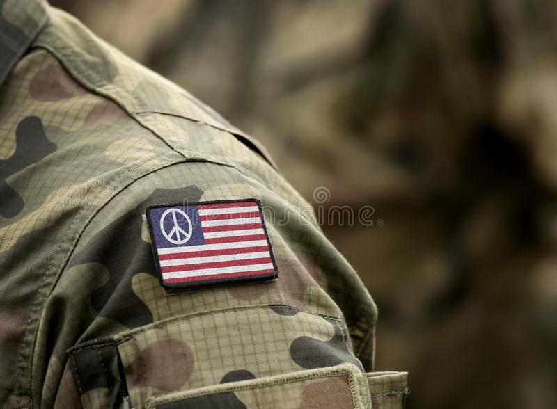 United States flag with peace sign canton on military uniform. US Peace flag. Collage.  royalty free stock image