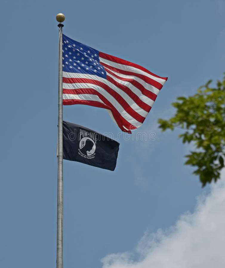 United States Flag POW MIA. A United States Flag flies together with a POW - MIA flag in downtown Raleigh, North Carolina stock image