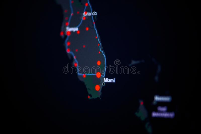 United States, florida, Tampa . Coronavirus COVID-19 global cases Map. Red Dot showing the number of infected. Johns Hopkins. University map on monitor display royalty free stock image