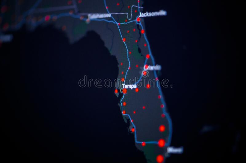 United States, florida, Tampa . Coronavirus COVID-19 global cases Map. Red Dot showing the number of infected. Johns Hopkins. University map on monitor display stock photos