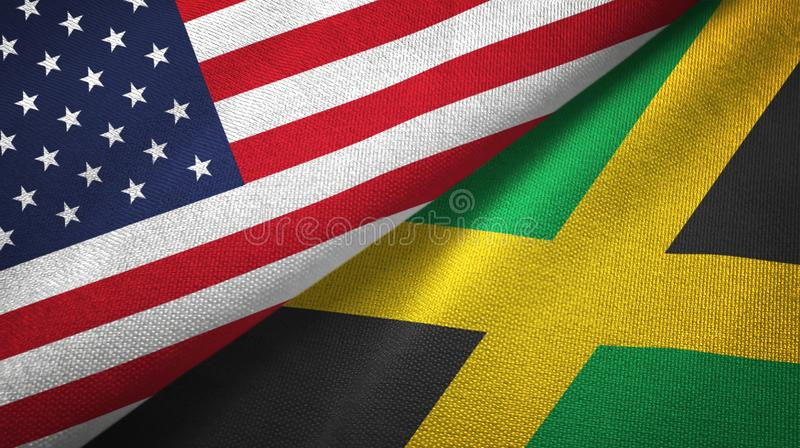United States and Jamaica two flags textile cloth, fabric texture stock illustration