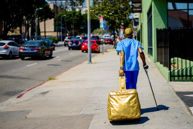UNITED STATES - June 02: Man who works as a golden living statue before starting working, June 02, 2016 in Los Angeles, United. Man who works as a golden living royalty free stock photo