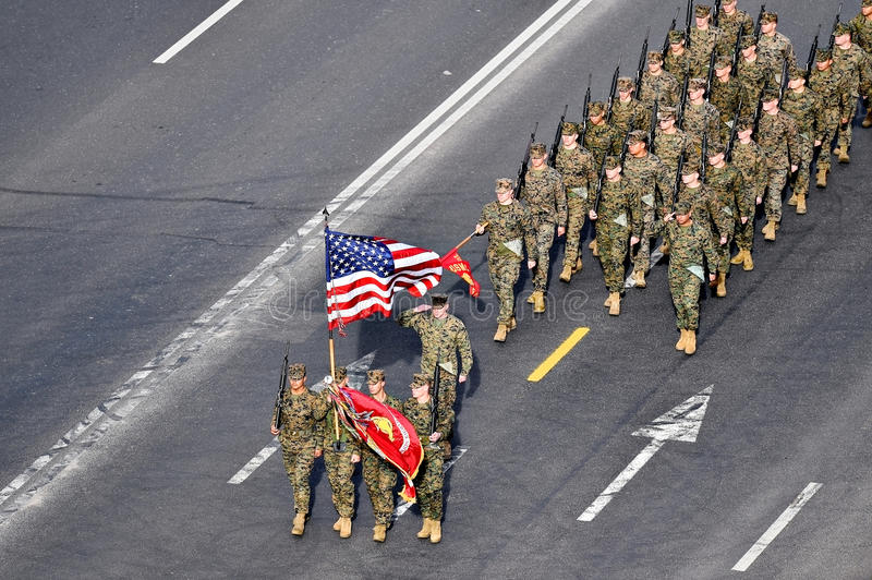 United States marines marching at military parade. BUCHAREST, ROMANIA - DECEMBER 1: Aerial photo with United States marines soldiers marching during the Romania' royalty free stock images