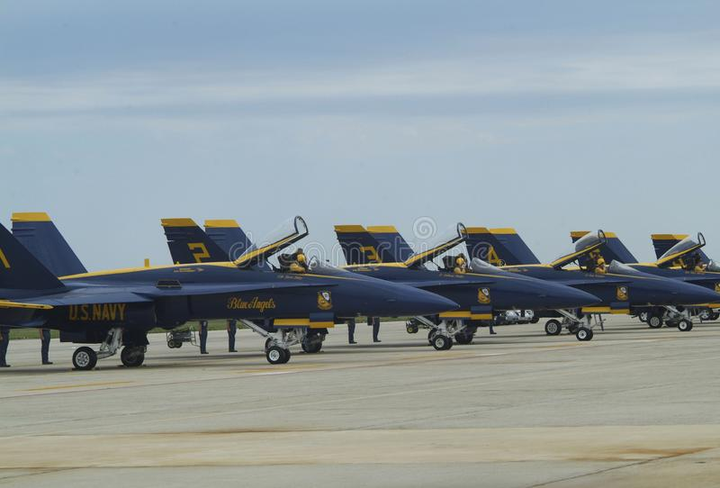 The United States Navy Blue Angels pilots prepare to start their engines. Blue Angel pilots prepare to start their engines at the at Andrews Air Force Base in royalty free stock photography