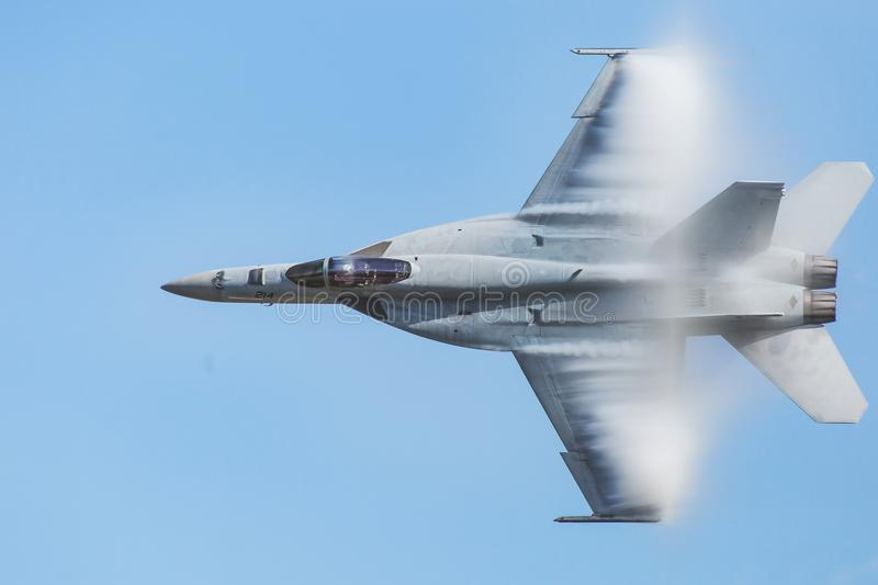 United States Navy F-18 Super Hornet. The United States Navy F-18 Super Hornet flying so fast that it forms a vapor cloud on its body. Houston, Texas 2017 royalty free stock image