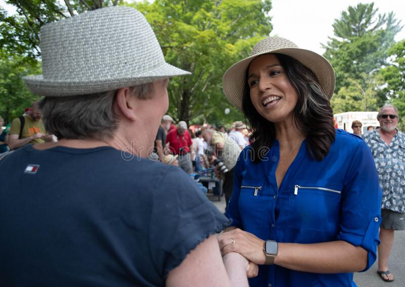 U.S. Rep. Tulsi Gabbard shakes hands during the July 4 parade in Amherst, New Hampshire, USA, on July 4, 2019. United States Representative Tulsi Gabbard, D stock photography