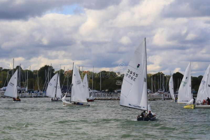 United States Sailing. Sailboats at a racing regatta leave the marina and head to the open water race at the United States Sailing Associations Championship of stock image