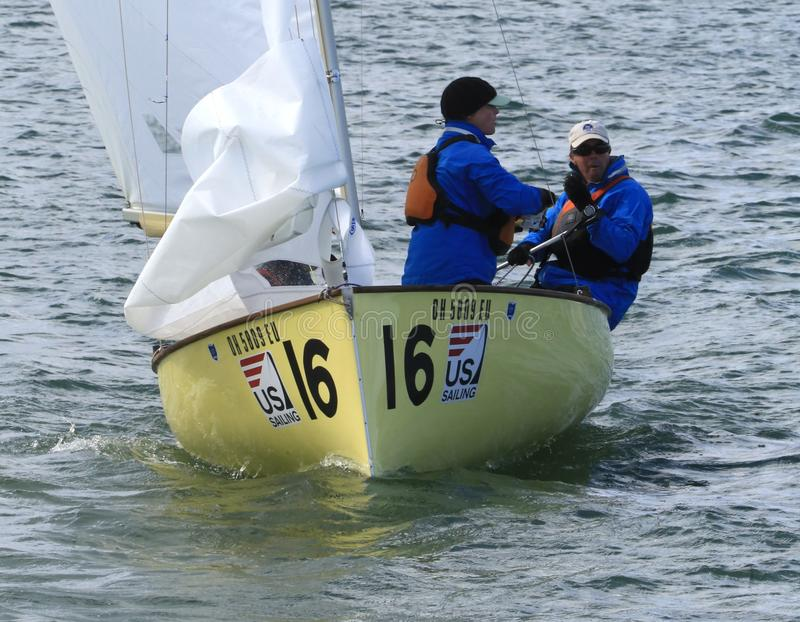 United States Sailing. Sailors control the sailboat in the calm water at the United States Sailing Associations Championship of Champions Title at Lake Erie stock photos