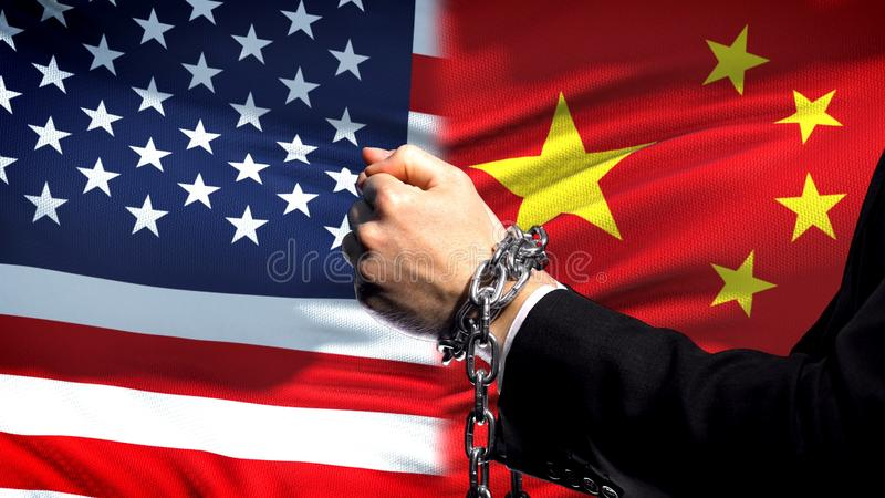 United States sanctions China, chained arms, political or economic conflict. Stock photo stock photography