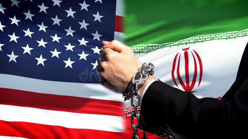 United States sanctions Iran, chained arms, political or economic conflict. Stock photo stock photo