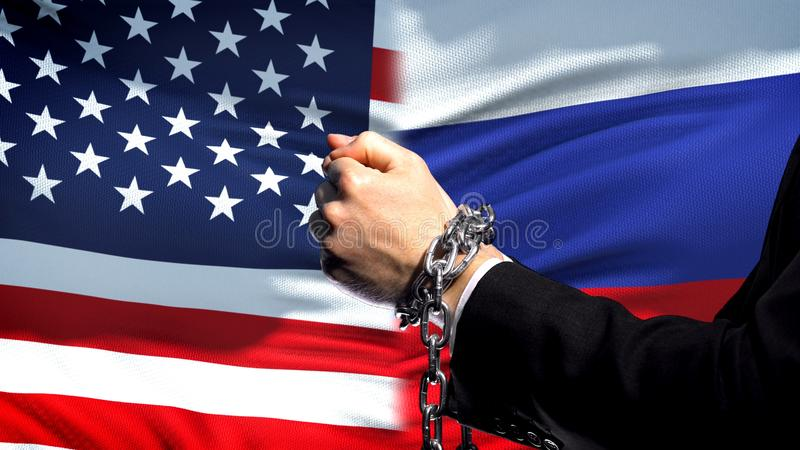 United States sanctions Russia, chained arms, political or economic conflict royalty free stock images