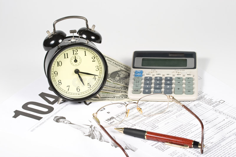 United States Tax Form. Calculator, dollars, alarm clock and pen royalty free stock image