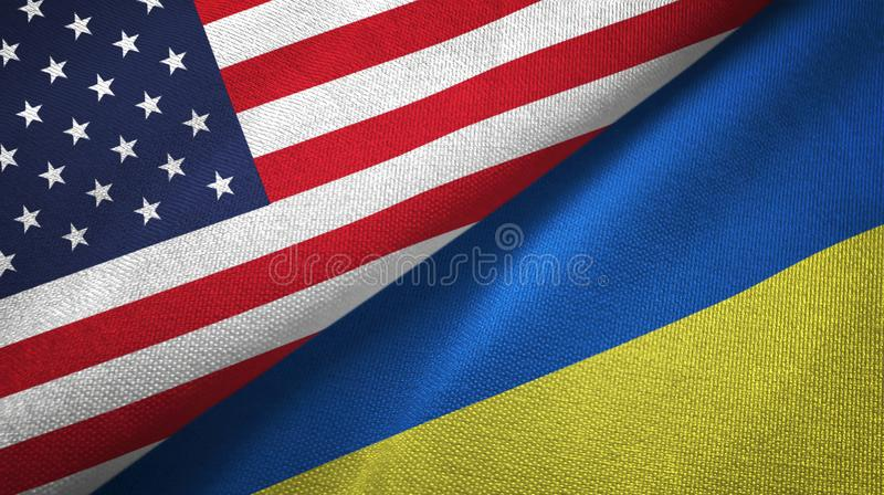 United States and Ukraine two flags textile cloth, fabric texture royalty free illustration