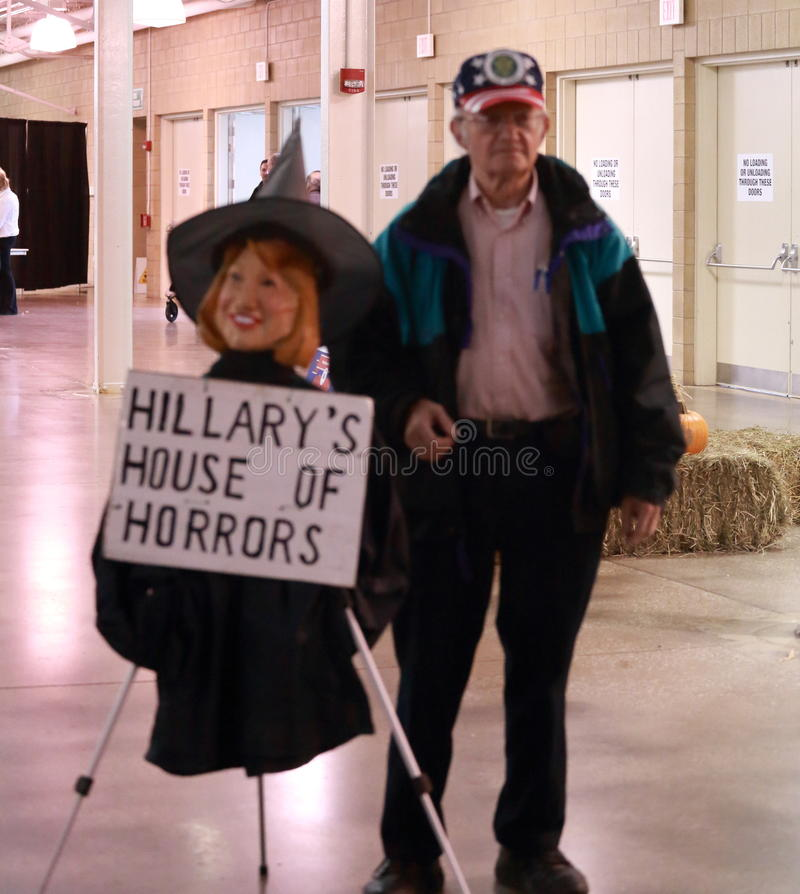 United States Veteran John Strong with Hillary Clinton effigy witch. Iowa Republican Growth and Opportunity Party, October 31, 2015, Des Moines, Iowa. United stock image