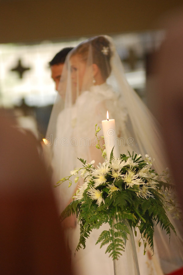Unity candle with bride and groom at church royalty free stock image