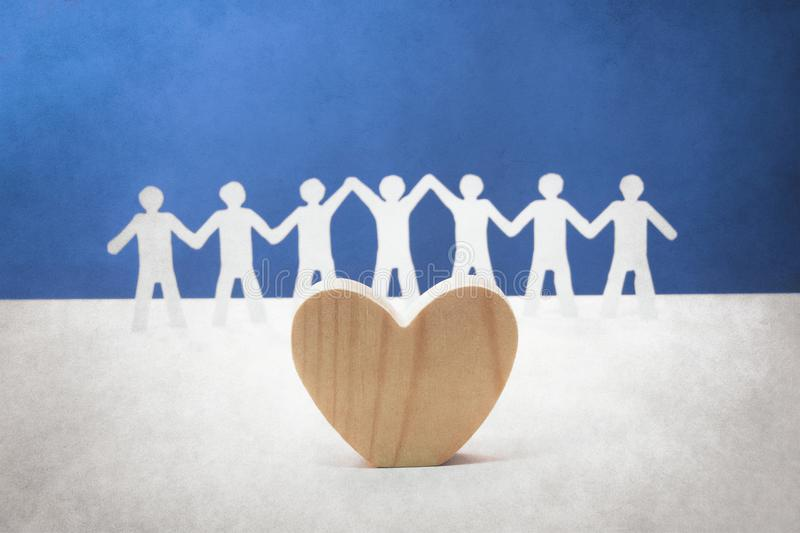 Unity and love of human. Concept of unity and love paper human and heart symbol stock photography