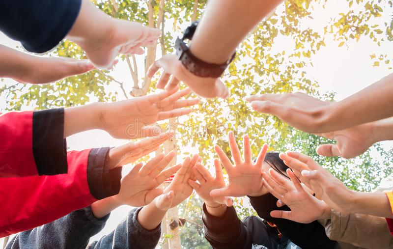 Unity and teamwork Concept: Blurred of Above Group students hands together in activities outdoor classroom. Asian young childrens royalty free stock image