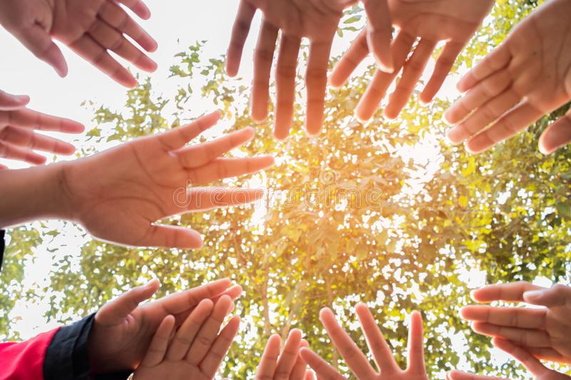 Unity and teamwork Concept: Blurred of Group students hands together in activities outdoor classroom. View of Asian young royalty free stock photography