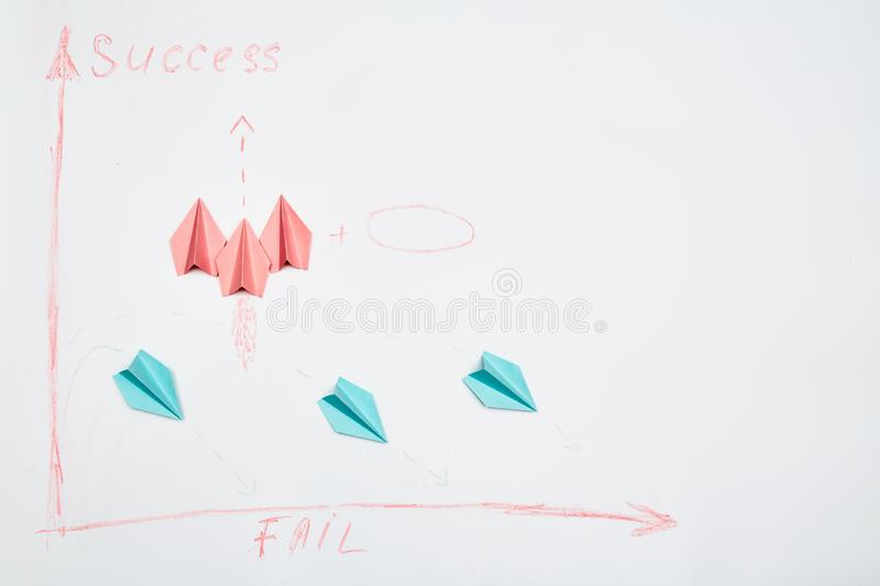 Unity and teamwork concept for business competition: A group of paper planes and origami rockets on a white background royalty free stock image