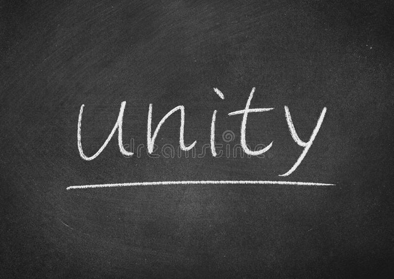 Unity. Concept word on a blackboard background stock photo
