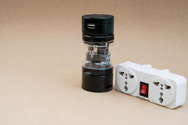 Universal adaptor with plug socket. For travelling stock image