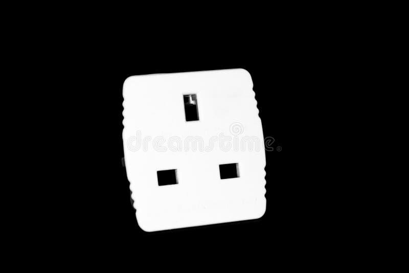Universal-AU US Großbritannien zum EU-Energiereiseadapter - Sockelkonverter lokalisiert auf Schwarzem stockbilder