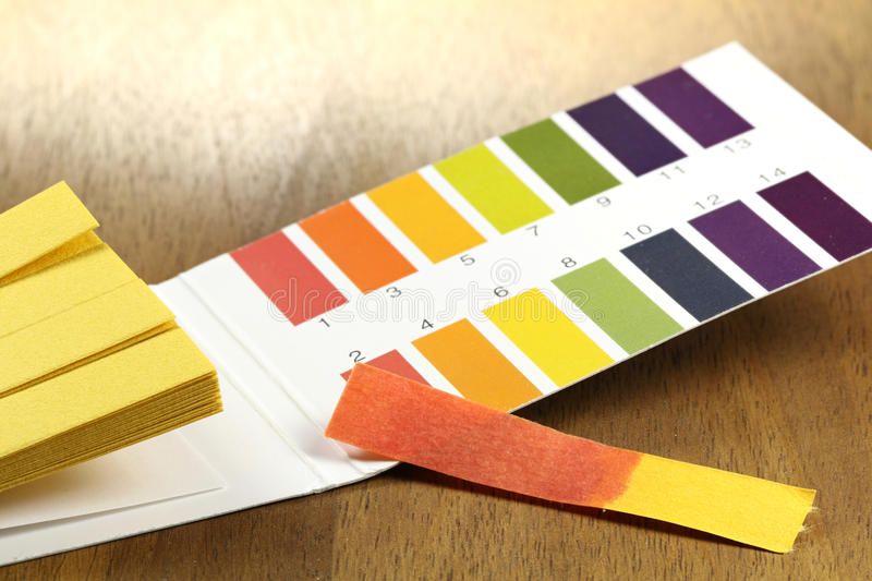 Universal indicator paper stock images