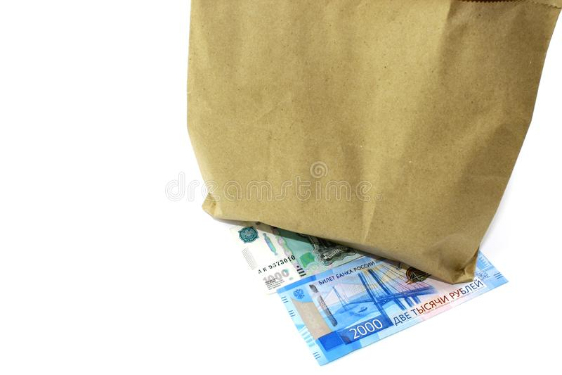 Universal packaging for various goods. Paper bag. Paper bag. The package is closed with a stapler. Inside are products purchased i. In the photo, a universal royalty free stock photography
