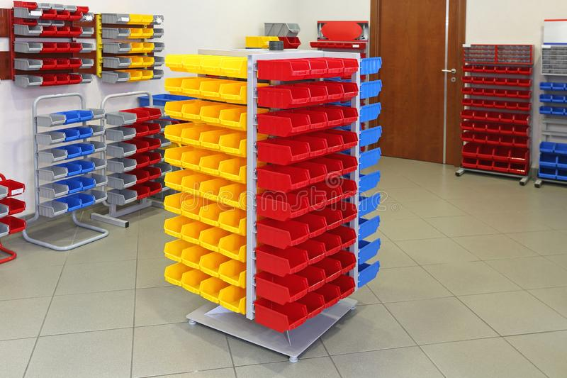 Universal Plastic Boxes. Universal Storage Organizer Rack With Plastic Bins and Boxes royalty free stock photos