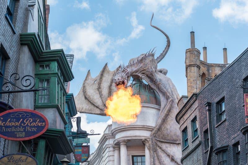 Universal Studios Dragon on Gringotts Bank. ORLANDO, USA - SEPTEMBER 02, 2015: Dragon on top of Gringotts bank breathing fire at The Wizarding World Of Harry