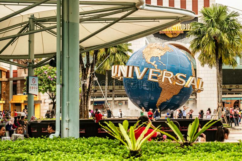 Universal Studios rotating globe sign in Singapore on Sentosa is. Singapore – Jan 13, 2017: Visitors are taking pictures at Universal Studios rotating stock photography