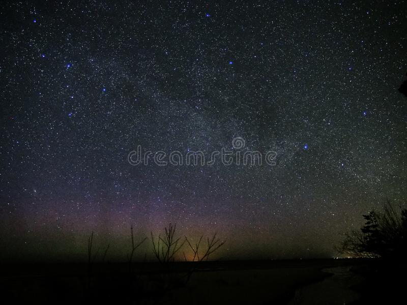 Universe and milky way stars in night sky cassiopeia constellation stock photo