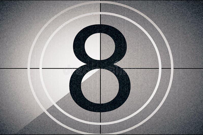 Universell filmledare, symbol som räknar ner från 8, med skärmen för chromatangentgräsplan på finalen, tappningstil arkivfoton