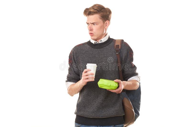 Universiteitsjongen ongeveer om lunch te hebben stock afbeelding
