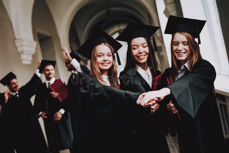 University. Campus. Girls. Cheerful. Celebration. stock photo