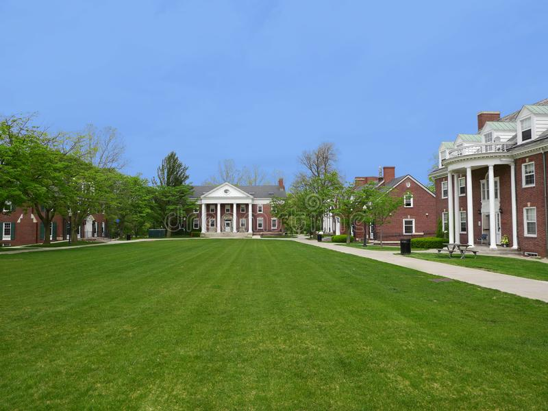 University Campus. Ivy League style University Campus with large lawn and residence buildings royalty free stock image