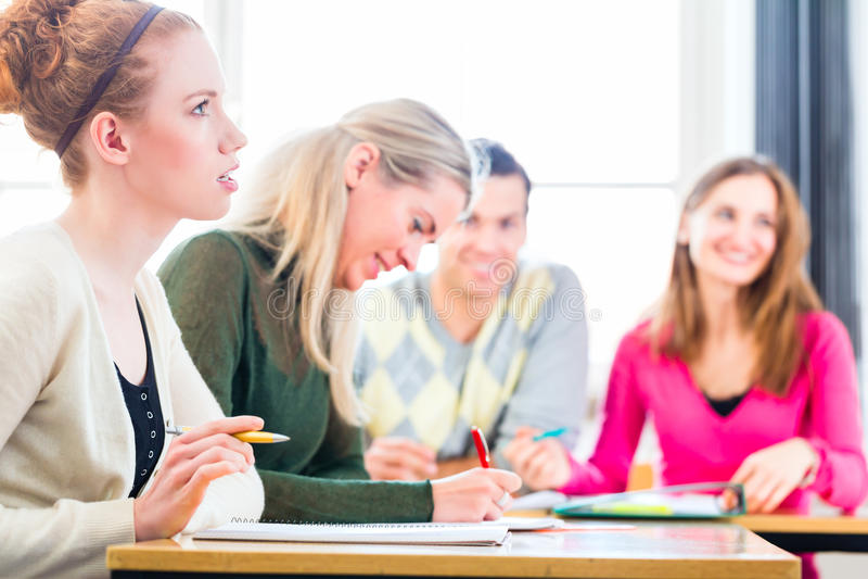 University college students having examination stock image