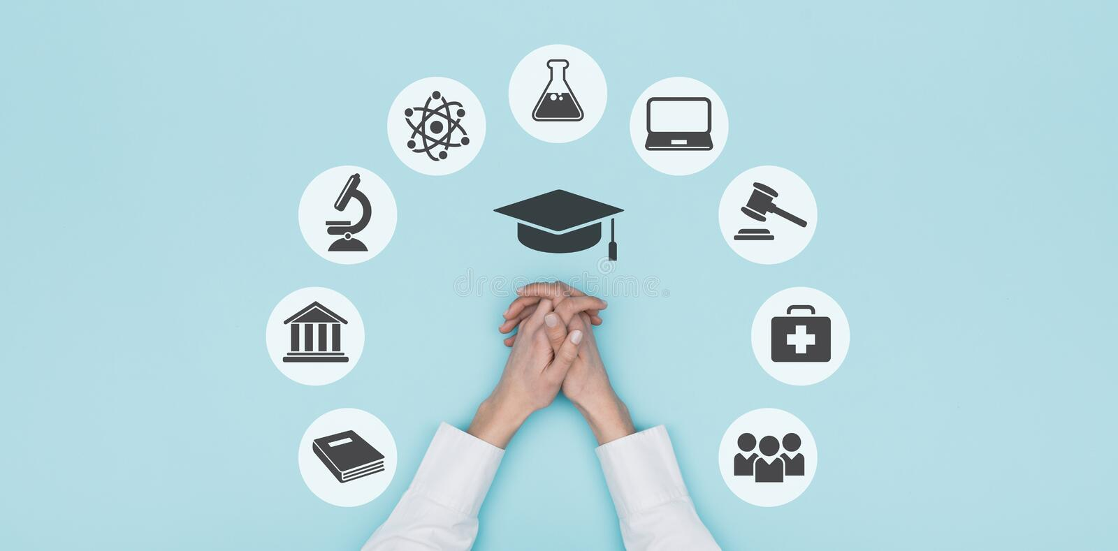 University and education icons. University, academy and education concept icons and student`s hands, top view: learning and career concept stock photo