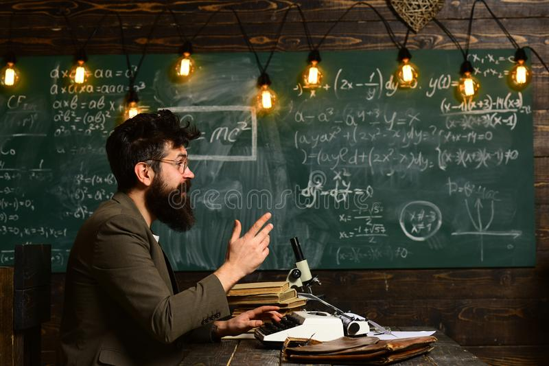 University male speaker conducts business training, Education and literacy concept - high school teachers give lectures stock photo