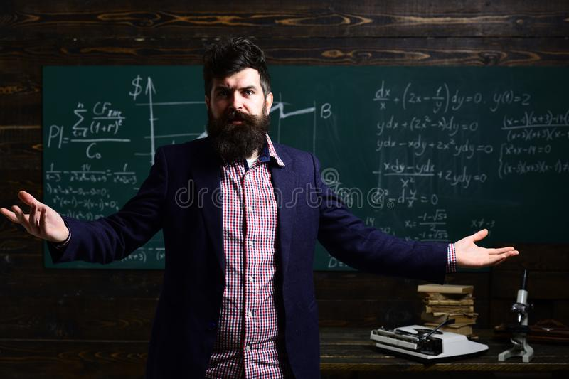 University male speaker conducts business training. Teacher is warm. Education and literacy concept - high school stock photos