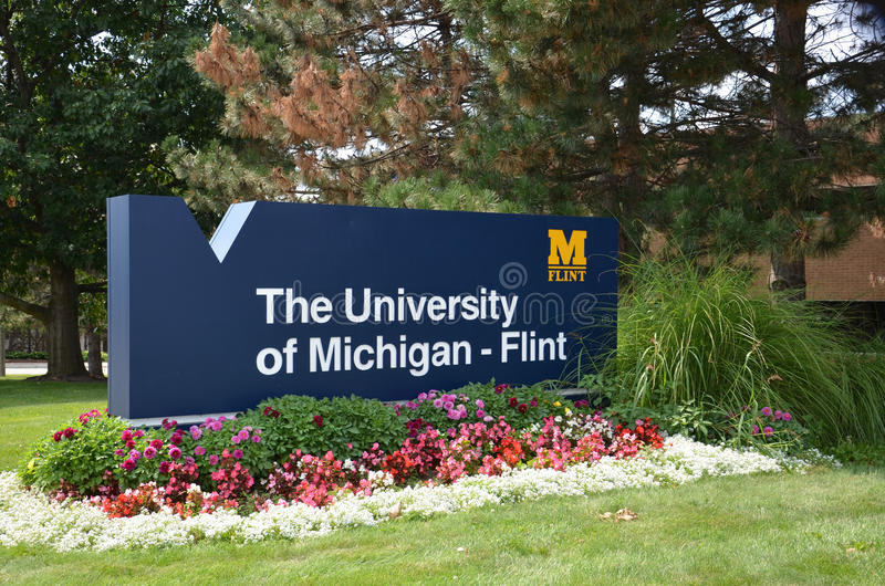 University of Michigan Flint sign. FLINT, MI - AUGUST 22: The University of Michigan Flint, whose sign is shown on August 22, 2015, is documentary director royalty free stock photos
