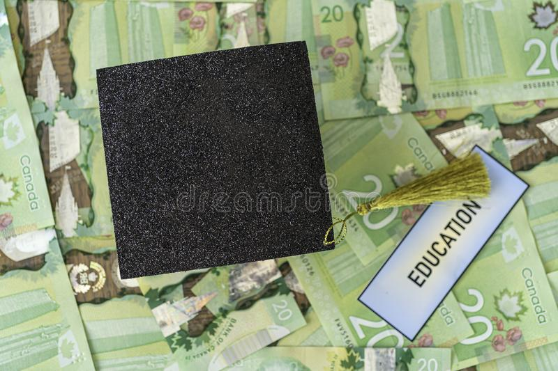 University Mortarboard academic cap on Canadian Dollar notes royalty free stock photos