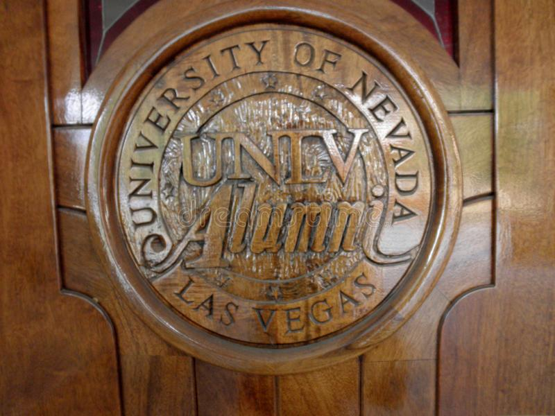 University of Nevada, Las Vegas UNLV Alumni emblem on wood door. Las Vegas - February 5, 2010: University of Nevada, Las Vegas UNLV Alumni emblem on wood door at royalty free stock images