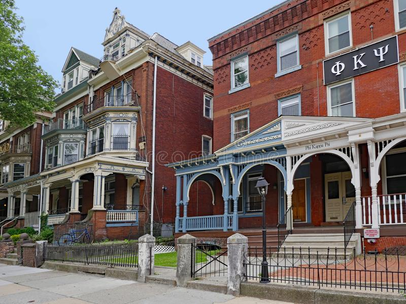 University of Pennsylvania, has many large old houses with large porches used as fraternity and sorority houses. The residential area around the University of royalty free stock images